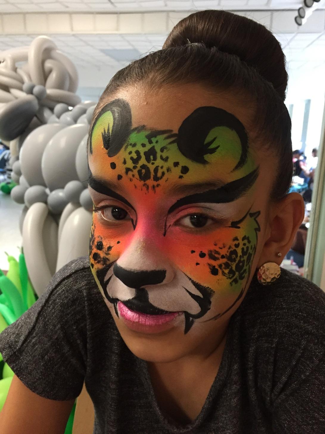 face painting in ct face painter paints a leopard